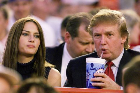 Real estate magnate Donald Trump and girlfriend, model Melania Knauss, take in game between the New York Mets and the Colorado Rockies at Shea Stadium