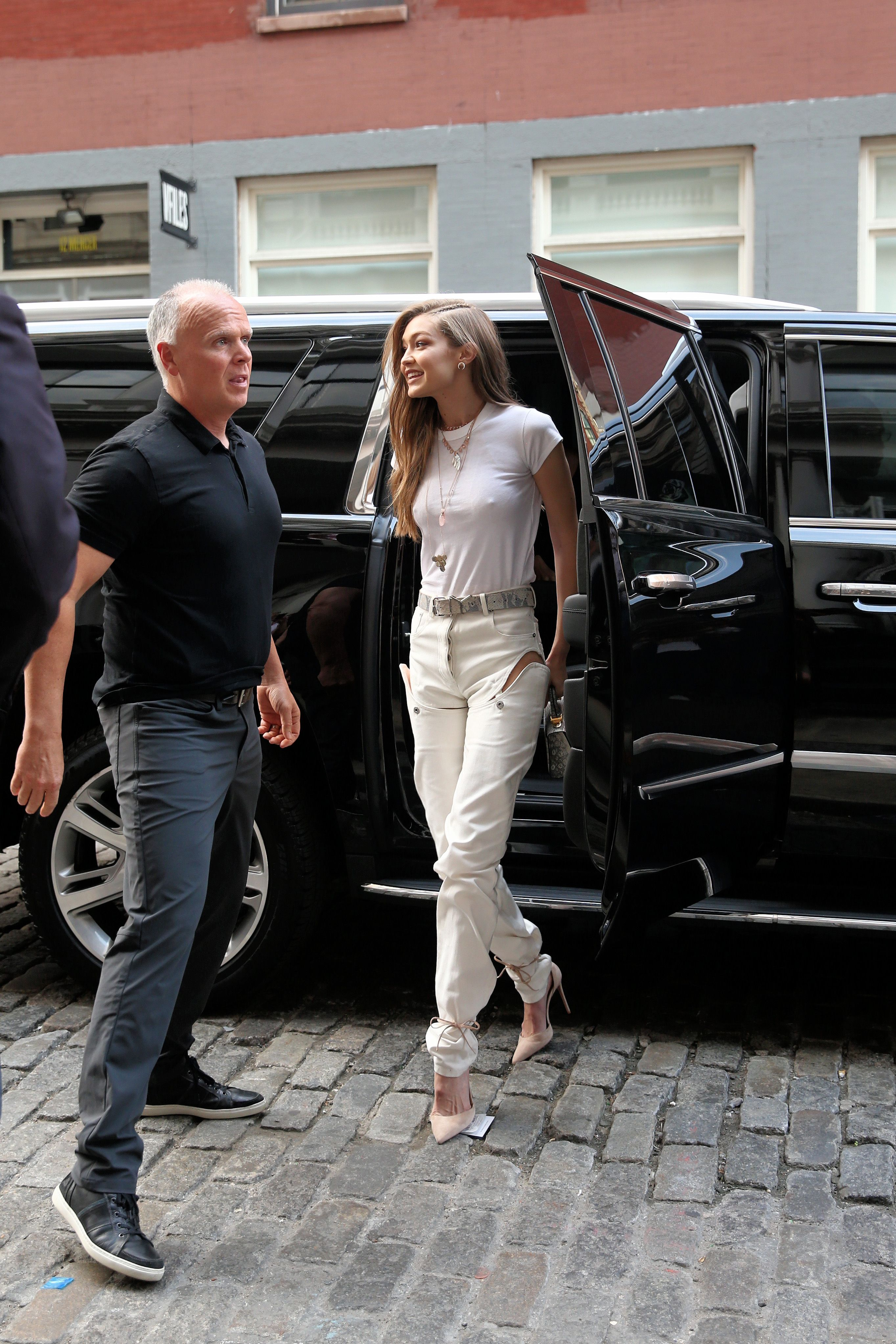 Gigi Hadid Wears Giant White Coat To Dinner In Nyc Inside Flats Khaky 40 Fashion Photos