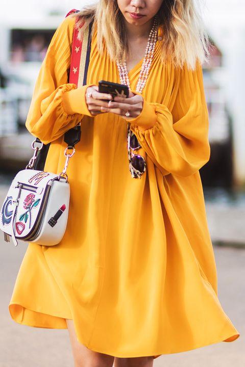 Clothing, Street fashion, Yellow, Orange, Fashion, Dress, Outerwear, Fashion model, Shoulder, Footwear,