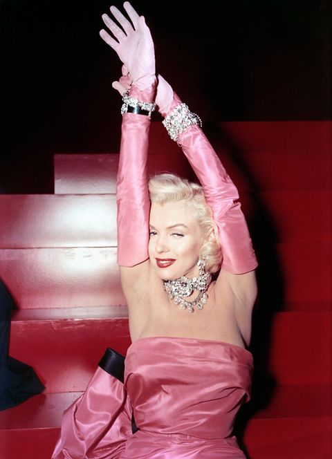 "<p>Pretty in pink while singing ""Diamonds Are a Girl's Best Friend,"" in the 1953 film <em data-redactor-tag=""em"">Gentlemen Prefer Blondes.</em></p>"
