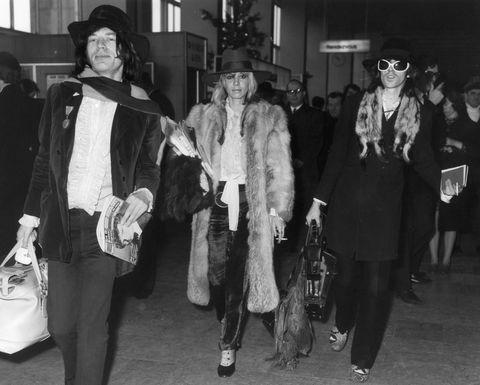 Photograph, Standing, Snapshot, Fashion, Fur, Monochrome, Black-and-white, Fur clothing, Outerwear, Textile,