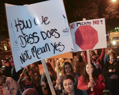 The annual 'Take Back the Night' march winds its way through Parkdale neighbourhood after leaving a park on Cowan Avenue where participants gathered for a rally prior to the march