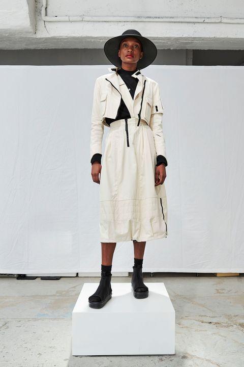Clothing, Trench coat, Fashion, Coat, Outerwear, Street fashion, Fashion design, Uniform, Overcoat, Beige,