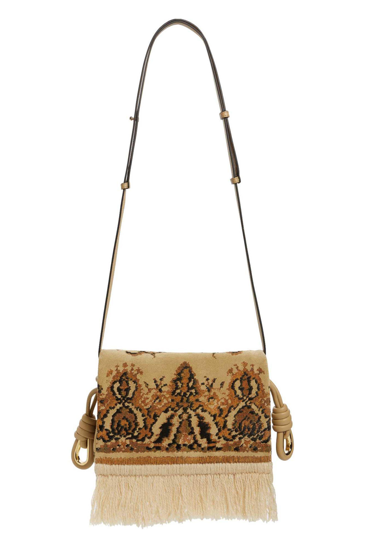 """<p>Loewe Flamenco Fringe Tapestry Calfskin Leather Bag, $876;<a href=""""http://shop.nordstrom.com/s/loewe-flamenco-fringe-tapestry-calfksin-leather-bag/4585075?origin=category-personalizedsort&fashioncolor=GOLD%20MULTITONE"""" target=""""_blank"""" rel=""""noopener noreferrer"""">nordstrom.com</a></p>"""