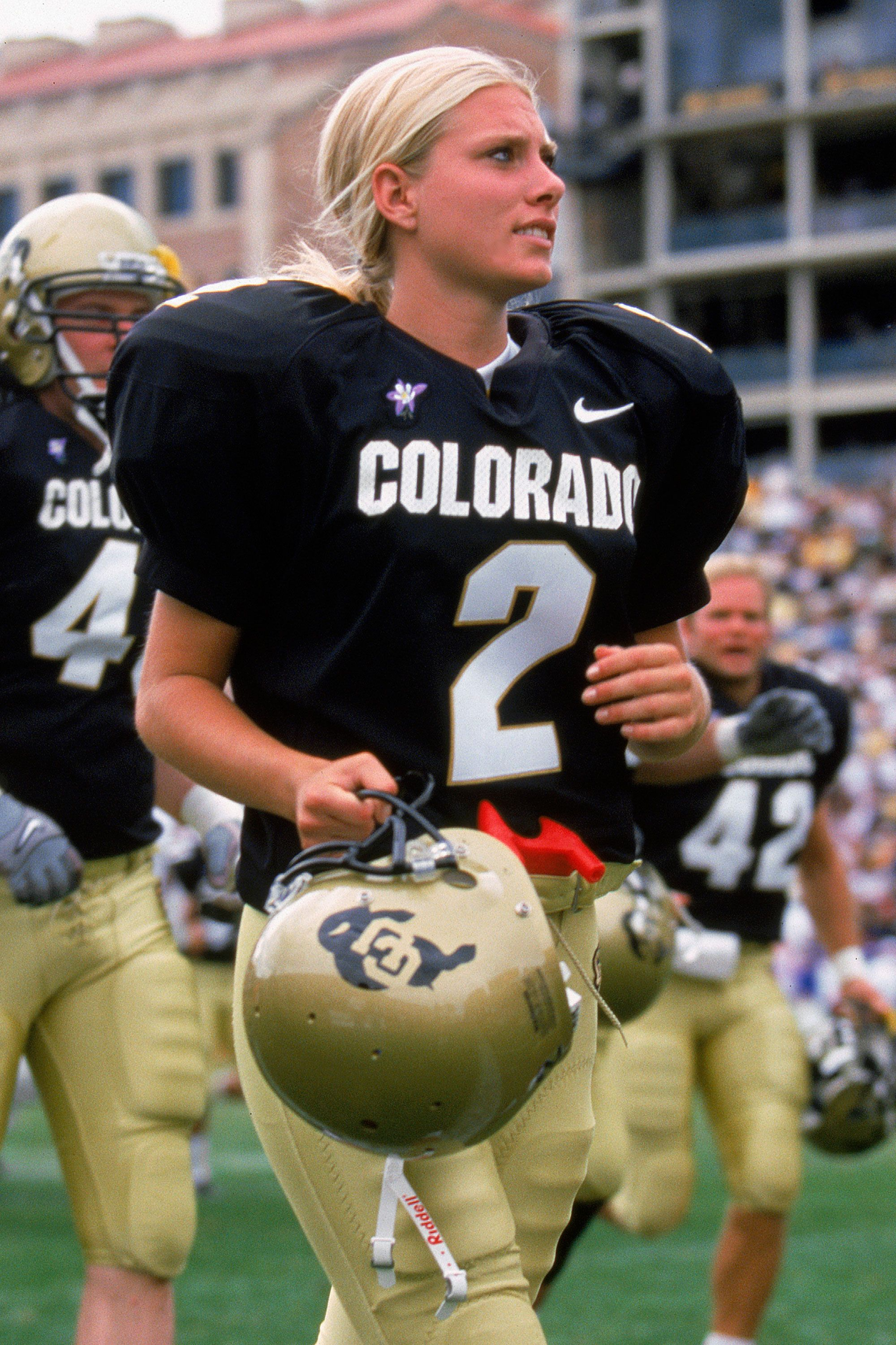 """<p>On August 30, 2003, Katie Hnida became the first woman to score points in an NCAA Division 1-A college football game as kicker for theNew Mexico Lobos<span class=""""redactor-invisible-space"""" data-verified=""""redactor"""" data-redactor-tag=""""span"""" data-redactor-class=""""redactor-invisible-space""""></span>at the University of New Mexico. In a game against Texas State University, Hnida kicked two points in the fourth quarter. Hnida was only thesecond woman to ever dress in a college football uniform<span class=""""redactor-invisible-space"""" data-verified=""""redactor"""" data-redactor-tag=""""span"""" data-redactor-class=""""redactor-invisible-space""""></span>in the U.S. Today, the number of women asked to play in the NCAA remains low, but Hnida helped prove that women can score points alongside the guys.</p>"""