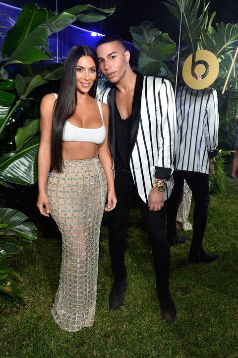 cebcfdbc83 Kim Kardashian Wears Tiny Crop Top and Sparkly Sheer Skirt to ...