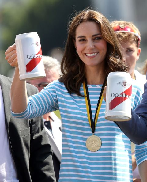 Catherine, Duchess of Cambridge celebrates with a beer after participating in a rowing race between the twinned town of Cambridge and Heidelberg and against Prince William, Duke of Cambridge.