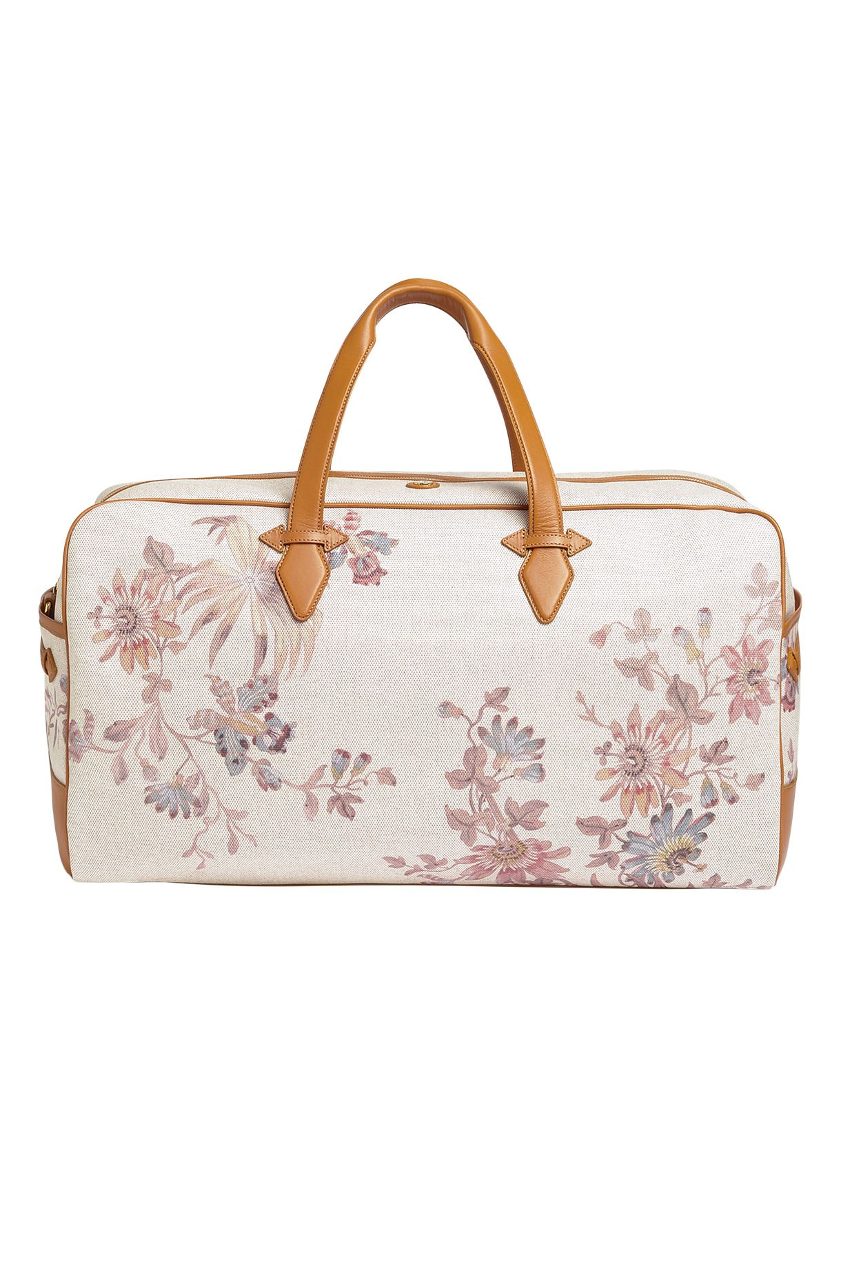 "<p>Traveling by car means no overhead constraints or worry about damaging (or losing) your luggage. Make the most of it with a pretty designer piece.</p><p><em data-redactor-tag=""em"" data-verified=""redactor"">Paravel Scout Floral Grand Tour, $445; </em><a href=""https://tourparavel.com/products/scout-floral-grand-tour/scout"" target=""_blank"" data-tracking-id=""recirc-text-link""><em data-redactor-tag=""em"" data-verified=""redactor"">tourparavel.com</em></a></p>"