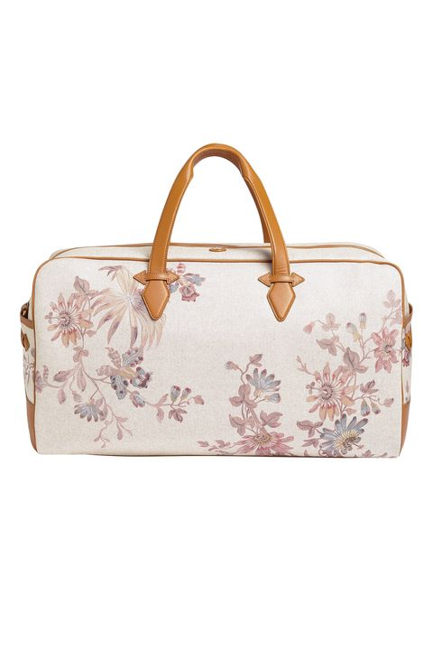"<p>Traveling by car means no overhead constraints or worry about damaging (or losing) your luggage. Make the most of&nbsp;it with a pretty designer piece.</p><p><em data-redactor-tag=""em"" data-verified=""redactor"">Paravel Scout Floral Grand Tour, $445; </em><a href=""https://tourparavel.com/products/scout-floral-grand-tour/scout"" target=""_blank"" data-tracking-id=""recirc-text-link""><em data-redactor-tag=""em"" data-verified=""redactor"">tourparavel.com</em></a></p>"