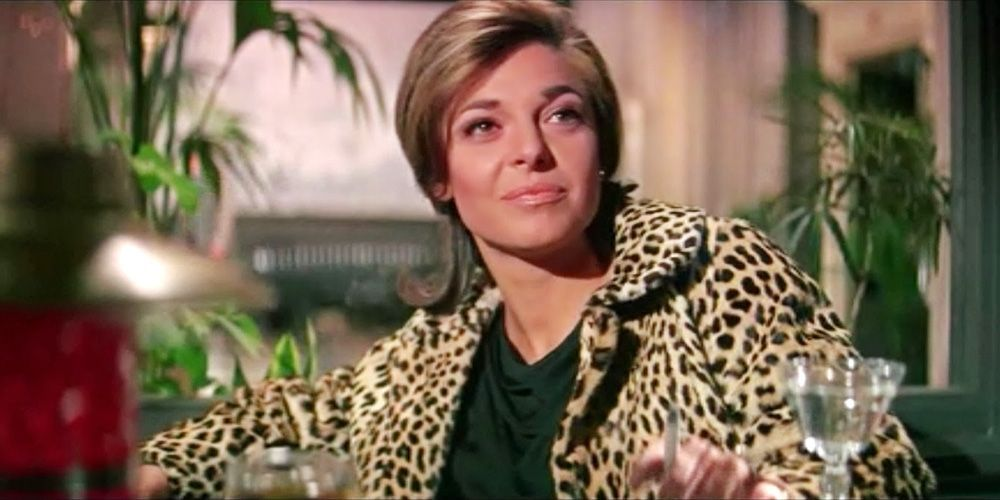 """<p>She may be one of the most iconic seductresses in cinematic history, but Mrs. Robinson's wardrobe is just as legendary. With leopard coats, silky slips, and that sheer little black dress, Mrs. Robinson (played by Anne Bancroft), not only invented the term """"cougar,"""" but also wrote the style book for it. </p>"""