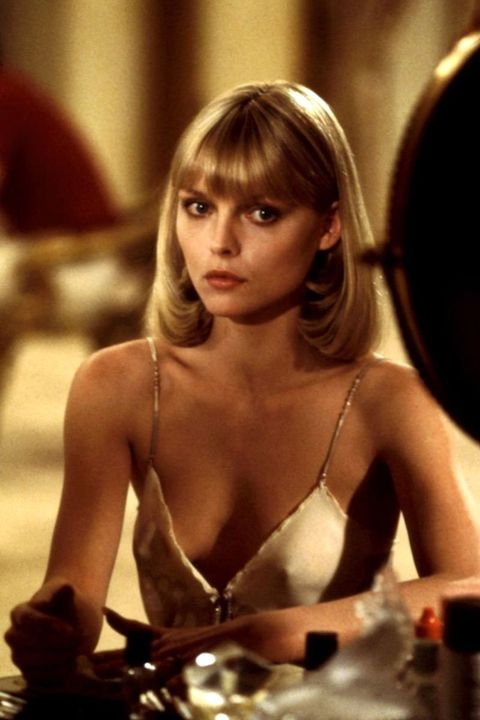 """<p>Michelle Pfeiffer transformed into a 1970s fashion dream as Elvira Hancock. From perfect slip dresses to plunging necklines and that chic all-white suit, Hancock's wardrobe stole the show in <em data-redactor-tag=""""em"""">Scarface</em>—and continues to inspire to this day. </p>"""