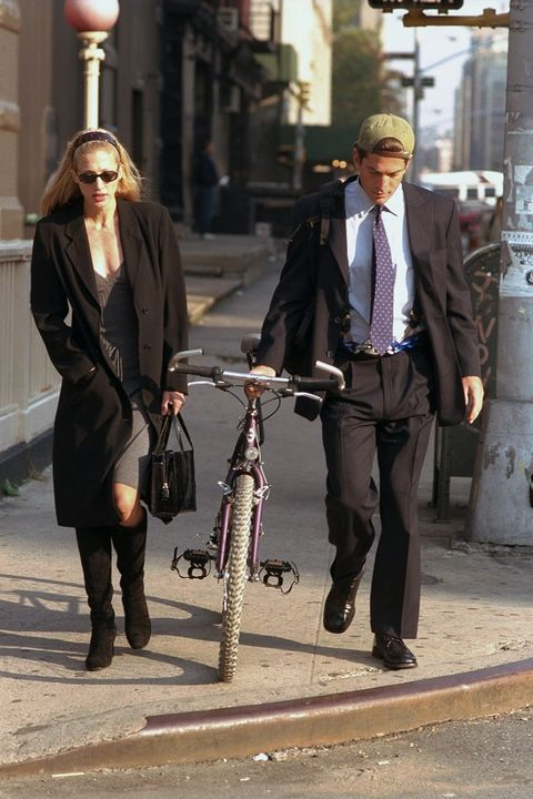 <p>Arguably the most famous slip-dress advocate of the era, Besette-Kennedy strolls through downtown NYC with her husband, 1996. </p>