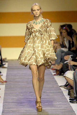 Clothing, Footwear, Leg, Fashion show, Shoulder, Runway, Human leg, Joint, Outerwear, Dress,