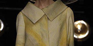 Collar, Sleeve, Brass, Costume design, Wind instrument, Mannequin, Button, Clothes hanger, Fashion design, Woodwind instrument,