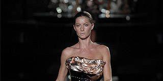 Dress, Shoulder, Human leg, Joint, Fashion model, Style, Fashion show, Runway, Thigh, Beauty,