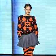 Clothing, Blue, Sleeve, Human body, Shoulder, Fashion show, Joint, Style, Street fashion, Orange,