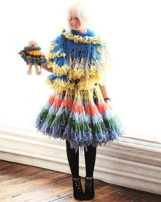 Clothing, Wood, Textile, Hardwood, Electric blue, Natural material, Fur clothing, Costume accessory, Headgear, Fashion,