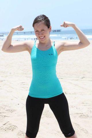 woman flexing muscles
