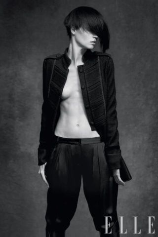 Black wool jacket, $895, silk pants, $425, both, Emporio Armani