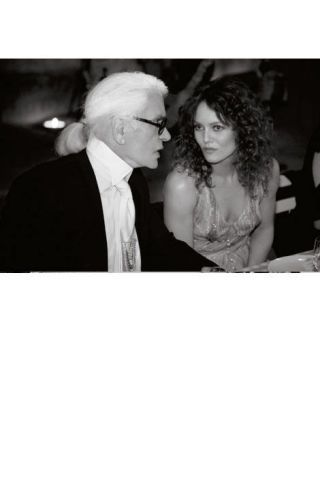 Lagerfeld with Paradis at dinner.
