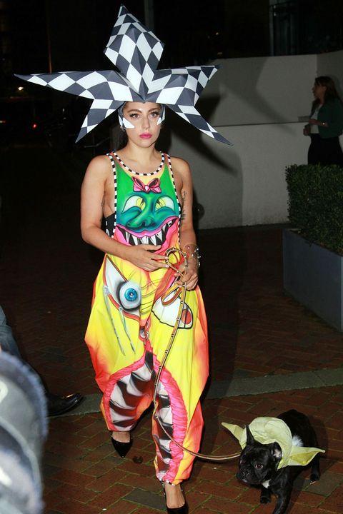 Costume accessory, Fashion, Costume, Fashion model, Fashion design, Costume design, Sandal, Costume hat, Bull, Model,