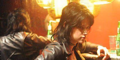 Jacket, Textile, Leather jacket, Leather, Black hair, Bottle, Top, Plastic bottle, Belt, Pocket,