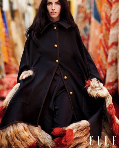 Sleeve, Textile, Overcoat, Fashion, Street fashion, Fur, Natural material, Costume, Fashion model, Costume design,