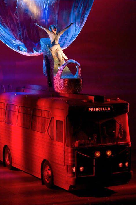 Bus, Double-decker bus, Red, Automotive lighting, Tour bus service, Fender, Rim, Automotive parking light, Commercial vehicle, Angel,