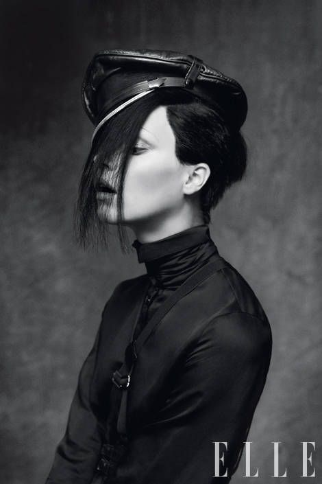 Black silk blouse, $450, leather braces, $295, both, Emporio Armani