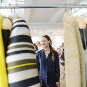 Yellow, Sleeve, Textile, Collar, Clothes hanger, Jacket, Fashion, Street fashion, Blazer, Boutique,