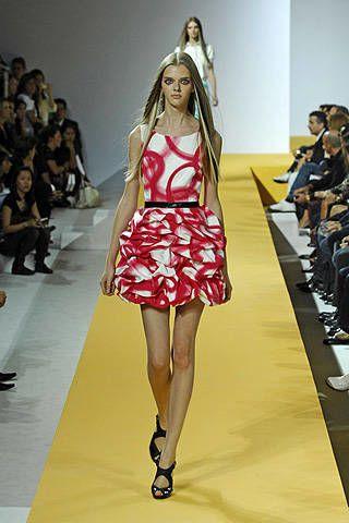 Clothing, Footwear, Leg, Event, Fashion show, Shoulder, Human leg, Joint, Runway, Dress,