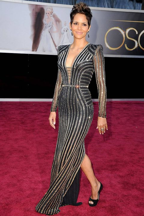 5ad4e97bd Halle Berry's Best Fashion Moments. See her many red carpet showstoppers. By  Kelsey Garcia