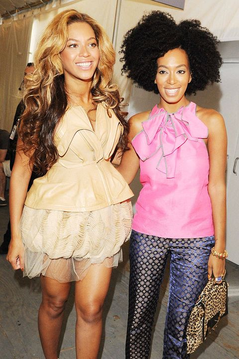 Clothing, Smile, Hairstyle, Jheri curl, Style, Thigh, Fashion, Dress, Afro, Ringlet,