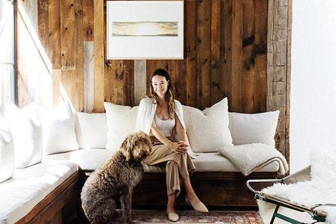 Human, Wood, Comfort, Mammal, Room, Interior design, Carnivore, Floor, Sitting, Couch,