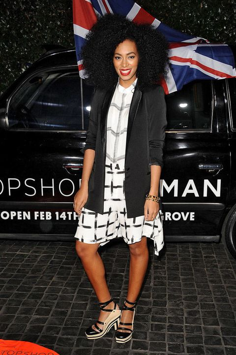 Shoe, Flag, Outerwear, Human leg, Style, Fashion accessory, High heels, Street fashion, Alloy wheel, Sandal,