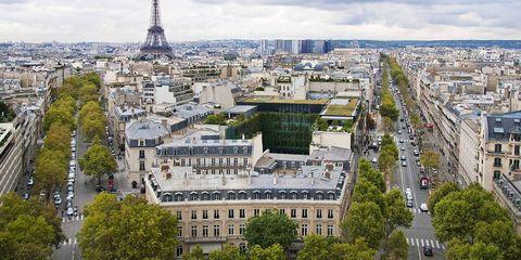 Daytime, Metropolitan area, Cloud, City, Urban area, Architecture, Neighbourhood, Landmark, Roof, Facade,