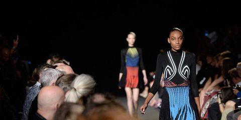 Fashion show, Dress, Fashion, Runway, Darkness, Fashion model, Street fashion, Public event, Fashion design, Blond,