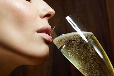 Lip, Cheek, Drinkware, Glass, Fluid, Drink, Barware, Eyelash, Wine glass, Liquid,
