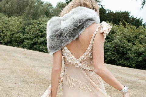 Textile, Dress, Costume accessory, Headgear, Beige, Fur, Natural material, Day dress, Embellishment, Fur clothing,