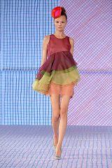 Human leg, Dress, Shoulder, Textile, Joint, One-piece garment, Fashion show, Waist, Magenta, Pattern,