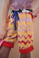Blue, Yellow, Sleeve, Human leg, Pattern, Textile, Joint, Red, Orange, Thigh,