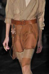 Clothing, Leg, Brown, Sleeve, Human leg, Shoulder, Textile, Joint, Khaki, White,