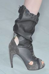 Human leg, Joint, Boot, Fashion, Black, Grey, Leather, Foot, Synthetic rubber, Silver,