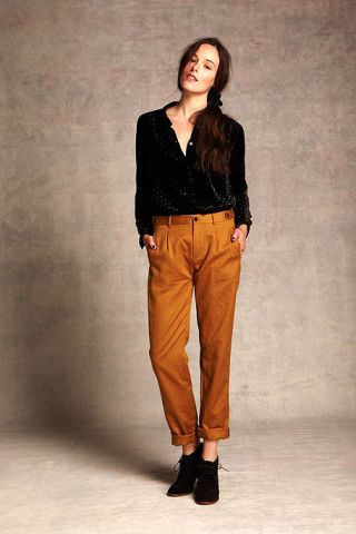 Clothing, Brown, Sleeve, Human body, Shoulder, Collar, Textile, Joint, Standing, Style,