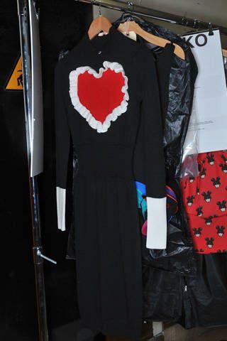 Collar, Textile, Clothes hanger, Fashion, Black, Boutique, Mannequin, Heart, Fashion design, Boot,