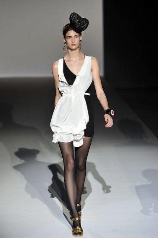 Clothing, Leg, Dress, Fashion show, Shoulder, Human leg, Joint, Fashion model, Style, One-piece garment,