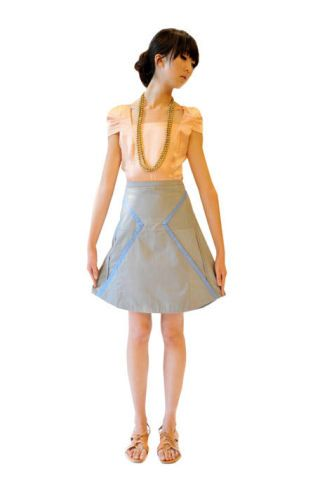 Brown, Sleeve, Human leg, Shoulder, Standing, Joint, Formal wear, Style, Waist, One-piece garment,