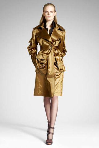 Clothing, Brown, Sleeve, Human body, Shoulder, Collar, Textile, Coat, Joint, Human leg,