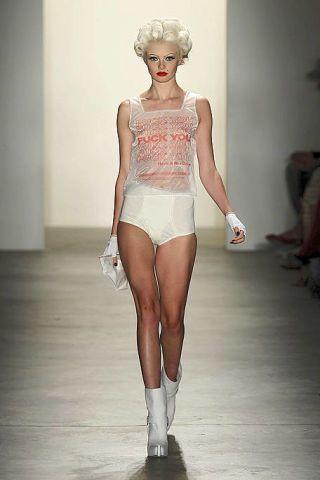 Skin, Shoulder, Human leg, Joint, Fashion show, Waist, Floor, Fashion model, Thigh, Knee,