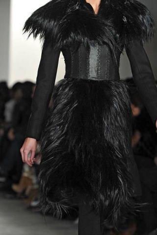 Textile, Fashion show, Style, Fashion model, Waist, Fur clothing, Fashion, Black, Fur, Natural material,